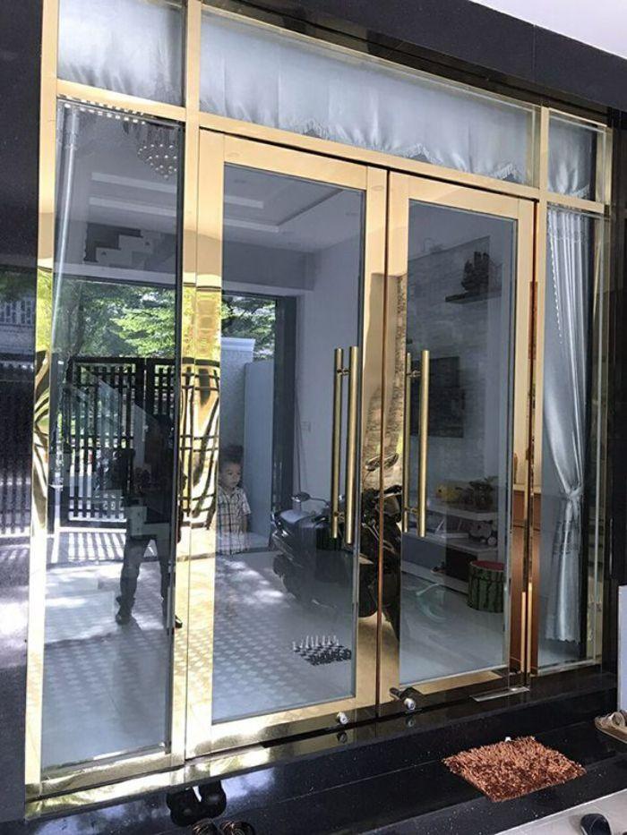 Cửa kính khung inox mạ vàng đẹp, sang trọng