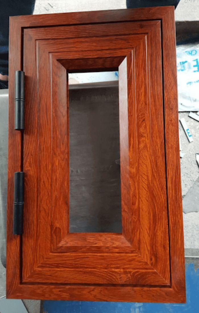 Cửa nhôm Xingfa vân gỗ 1 cánh mẫu 1