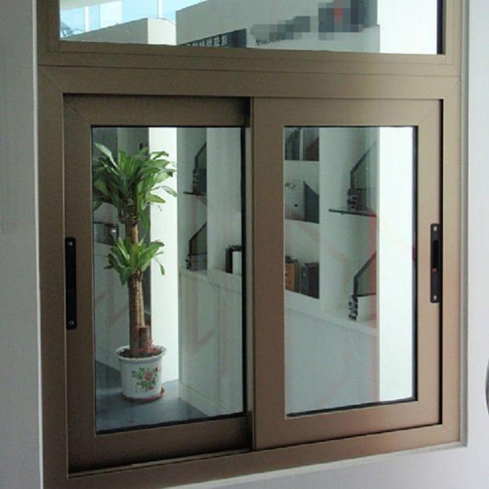Mẫu cửa sổ nhôm kính 2 cánh trượt lùa màu nâu cà phê