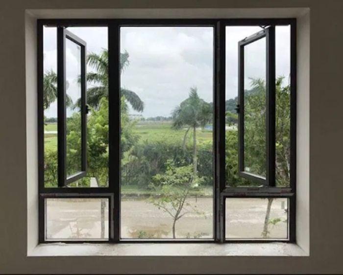 Mẫu cửa sổ nhôm kính mở quay kết hợp với vách kính lấy sáng