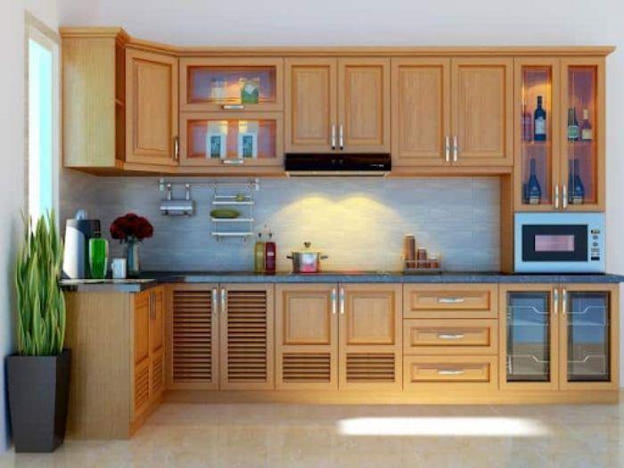 Tủ bếp nhôm chữ L giả vân gỗ thanh lịch có kính cường lực