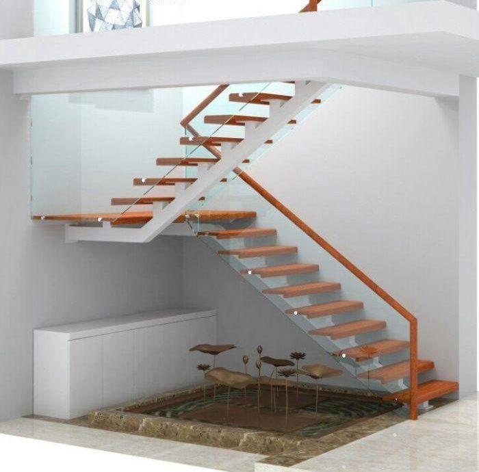 Cầu thang kính cường lực xương cá có tay vịn gỗ